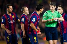 (L-R) Sergio Busquets, Andres Iniesta, Luis Suarez and Jordi Alba argue with the referee Alberto Undiano Mallenco (2nd R) during the La Liga match between FC Barcelona and Club Atletico de Madrid at Camp Nou on January 11, 2015 in Barcelona, Catalonia.