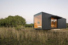 shipping container home in field