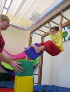 hanging from ladder and kicking boxes greast for sensory integration re-pinned by RecyclingOT.com
