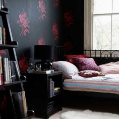 Black bedroom with pink decorative design
