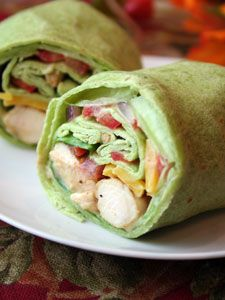 Grilled chicken wraps. I made these for a luncheon recently and used a bottled ranch-chipotle salad dressing for the spread. Perfect! These are very good.