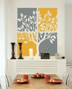 this would look awesome above our bed since our bedpread has a big tree on it.  i'd want it in blue and green