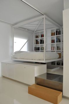 Floating bed with built-in bookshelf in a modern minimal bedroom by Small Space Interior Design, Small Bedroom Designs, Interior Design Living Room, Minimal Bedroom, Modern Master Bedroom, Master Bedrooms, Blue Gray Bedroom, Tiny Apartments, Small Living