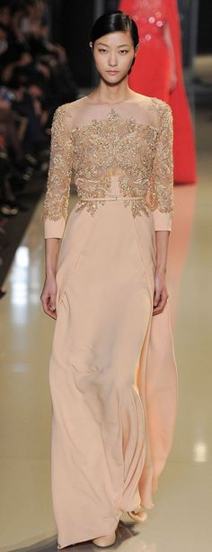 Peach colored gown with 3/4 sleeves and lace and beaded bodice. Paris Haute Couture: Elie Saab spring/summer 2013