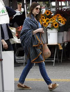 Stylish lady: Anne Hathaway looked lovely while spending a relaxing Sunday with her husban...