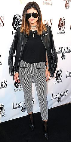 Kylie is auditioning for a heavy metal band. Kidding! But the young star puts her edginess on full display in high-waisted striped pants, a black moto jacket, tons of cool necklaces and some oversize aviators at Tyga's Last Kings store preview party in L.A.