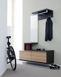 Furniture, Simple Modern Minimalist Entryway Table Cnlothing Hooks And Mirror Combined With Bookshelf For Narrow Modern Entryway Design With White Interior Color Decorating Ideas ~ 45 Entryway Storage Design Ideas to Try in Your House