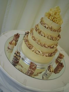 Astonishing 5 tier #weddingcake finished with #individualcakes for the top table...