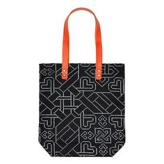 Our orange and navy Woodcut Print Tote features a subtle heart design for valentine's day