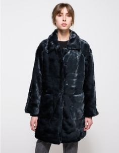 From Ganni, a mid weight faux fur jacket with coat styling in Total Eclipse.  Features pointed collar, concealed hook front closure, raglan sleeves, full length sleeve, front pouch pockets, straight hem, long silhouette and full lining.  •Mid weight fa