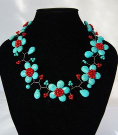 TURQUOISE AND SCARLET BEADED NECKLACE (by audreyjewelry on Etsy.com, $29.50) - I absolutely love the colors in this necklace!