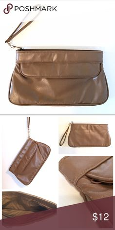 Vintage 80s Light Brwn Faux Lthr Wristlet + Clutch Vintage 80s Light Brown Faux Leather Wristlet + Clutch//Removable + Convertible Strap//Good Condition w/Normal Wear (see pic)//Let me know if you need add'l info or pics👍🏻 Vintage Bags Clutches & Wristlets