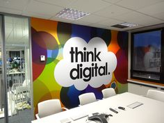 Direct Line Office Branding by Vinyl Impression in London. Colourful illustrative wall graphics applied around the office to improve the working environment for staff and visitors.