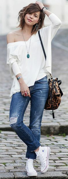 Pair of hi-top converse + distressed jeans + an off the shoulder top + Zoé Alalouch + hot spring style + casual but stylish   Top: Luie, Jeans: Zara, Shoes: Converse.