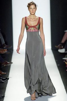 Bill Blass - it's lovely.  But i'll bet you need to be flat(ter) chested for this to look good on :(