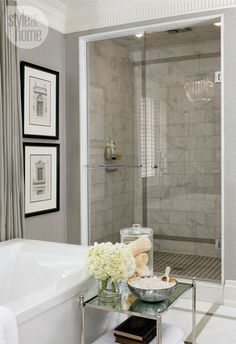 Absolutely beautiful chic bathroom space! From the nickel mirror top table to the marble walls and chandelier!