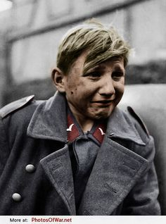 15 year old Flakhelfer Hans-Georg Henke after being taken captive by soldiers of the 9th U.S. Army in Rechtenbach, Hesse, Germany, 3rd April 1945. Photo taken by John Florea. He should be down on his knees thanking God his was caught by the Americans and not the Russians.
