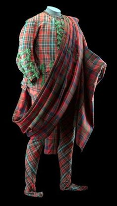 Sir John Hynde-Cotton's Highland suit made in Scotland in 1744. It comprises; coat and trews in one tartan plus a joined plaid in a different tartan. The suit is now on display in the National Museum of Scotland.