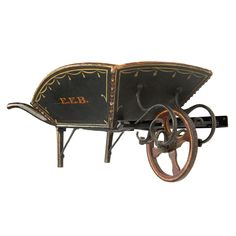 A TREMENDOUS CHILD'S WHEELBARROW FROM MAINE, CA 1840-1870:        Ex scudder smith. Great iron work and excellent paint-decorated surface.