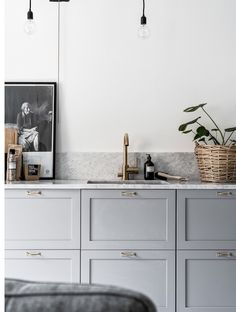 Greasy cabinets, brass handles and tap in a Swedish kitchen,