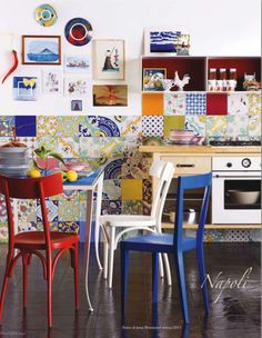 A wall of tiles in the kitchen....so random but really works....wish I had a potting shed to use this idea!