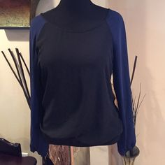 Nice Blue and Black top Cute Too worn a Few Times. Its an Elastic Fitted Waist and Sleeves!!! One Top Button on the back!!! Blue Sleeves, Black Torso and Back!!! Tops