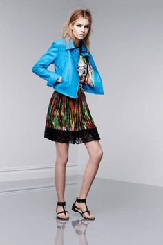 Look 5: Leather jacket in Dresden blue, $199.99; sleeveless tee in First Date print, $26.99; pleated skirt in Nolita print, $29.99; flat sandals, $29.99