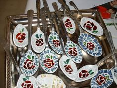 A silver tray full of ~~ Plant Charms~~ Micro Mosaic on Spoons!  By: Diane Erickson...   ....Some spoons include a Currier and Ives or a Blue Willow plate border........