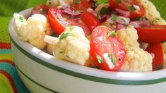 Cauliflower and cherry tomatoes make a festive duo in this crunchy salad with a light dressing. Bring to any summer picnic or Memorial Day barbeque.