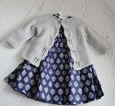 Aida top down cardigan knitting project by Oge Knitwear Designs. Find more inspiration and baby patterns at LoveKnitting.Lovely Knit Top Down Cardigan Baby Sweater A knit top down cardigan baby sweater called Norwegian Fir by Oge Knitwear Designs! Baby Cardigan Knitting Pattern, Knitted Baby Cardigan, Knit Baby Sweaters, Baby Pullover, Knitted Baby Clothes, Crochet Jacket, Baby Knitting Patterns, Baby Patterns, Baby Knits