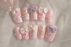 Fussy pink artificial nails