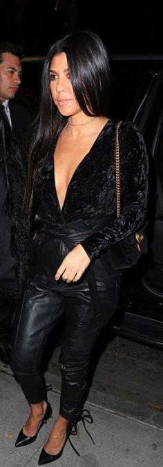 Who made  Kourtney Kardashian's black pumps, velvet jumpsuit, and gold chain handbag?