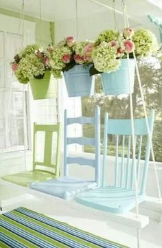 I absolutely love this swing!!! Not too sure about the plants....head bumps, falling or stuff falling off plants. Courtesy of Country Living.