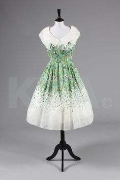 An embroidered organza dress, attributed to Christian Dior, 'Sinous' collection, Spring-Summer 1952, with notched 'puritan' collar, embroidered with grasses in shades of green and appliquéd with pink rose buds.