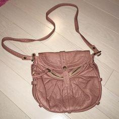 Pinkish/purple cross body bag Zipper on front, zipper inside, and 2 pockets inside Deena & Oozzy Bags Crossbody Bags