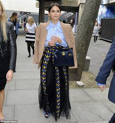 Mind your step: Miroslava Duma opted for a lilac blouse and voluminous skirt with vibrant pattern before taking to the stage to speak at the event