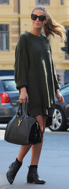 Benedichte is wearing an oversized knit military green sweater from H&M, dress from Camilla Pihl By Bianco and the boots and the bag is from Saint Laurent