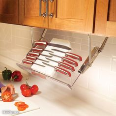 Pull-down racks give you instant access to kitchen essentials without the clutter of spice racks or knife holders. When the cooking is done, the rack swings up against the underside of the cabinet. The acrylic knife rack like the one shown here, or buy a pair of hinges only and make your own wooden rack to hold knives, spices or other small items that take up counter space.