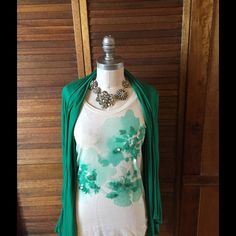J. Crew tissue tee with shrug J. crew xs embellished tissue tee with green floral sparkly accents, paired with Banana Republic jersey green long sleeve matching waterfall shrug size M. Preowned excellent condition .Both included J. Crew Tops Tees - Short Sleeve