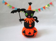 Halloween cat with a bat sitting on a pumpkin by RALOOLAND on Etsy