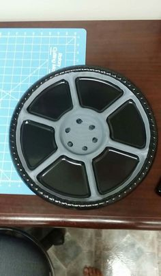 Make a wheel decoration out of a dollar store serving platter! Just a platter and grey paint..It was perfect for my son's car themed birthday party!