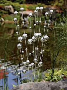 Wind Stalks - DIY: make with ping pong and plastic balls on wire stakes and spray with looking glass paint