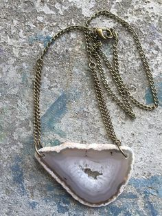 Hand drilled white agate slice necklace by ArcherPlusHare on Etsy https://www.etsy.com/listing/233183804/hand-drilled-white-agate-slice-necklace