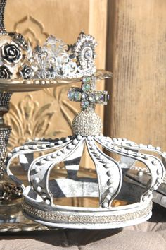 A beautifully finished rustic white metal crown with gorgeous rhinestone crystal embellishments. This crown was hand finished in my Studio