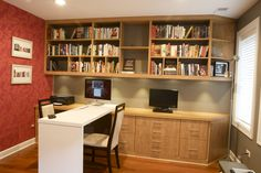 Now's the time to start making your holiday wish list...how about a space-saving, custom made desk to spruce up your home office!      Office area with meeting space and ample storage.