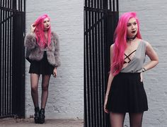 Get this look: http://lb.nu/look/8224405  More looks by Amy Valentine: http://lb.nu/amyvalentinex  Items in this look:  Mxci Deep V Harley Tank, Stone Fox Black Tennis Skirt, Yru Cherish Boots   #edgy #grunge #romantic
