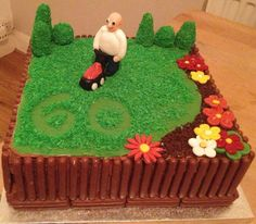 gardening cake with lawnmower and flowers and fence!