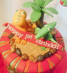 Dinosaur Train Cake! This cake was created for a client who saw our first Dinosaur Train cake and wanted a similar one created for her son's first birthday. French vanilla cake with edible imaging and hand sculpted fondant figures.