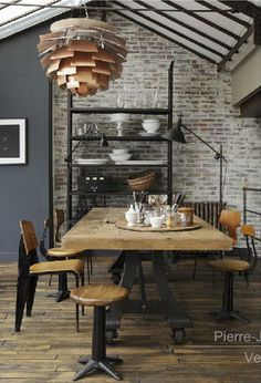 Industrial Dining Room with Artichoke Light Exposed Ceiling Beams and Exposed Brick Wall Industrial Dining, Industrial Interiors, Industrial House, Industrial Chic, Vintage Industrial, Industrial Industry, Design Industrial, Industrial Windows, Industrial Shelving