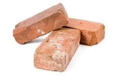 Photo of three red bricks.